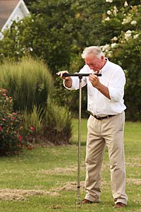 Bill Meagher collecting soil sample